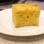 Slice of cornbread on a white plate