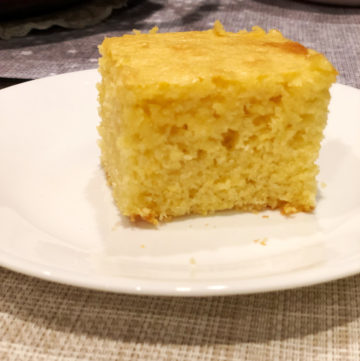 Slice of cornbread on a white plate